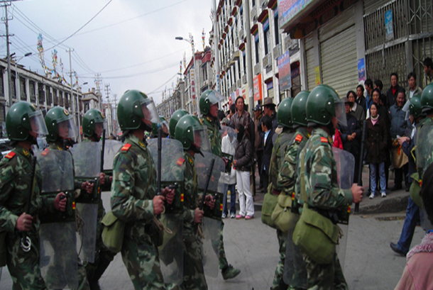 Chinese security forces patrol a street in Lhasa, the capital of Lhasa in 2008. Photo: TPI/File