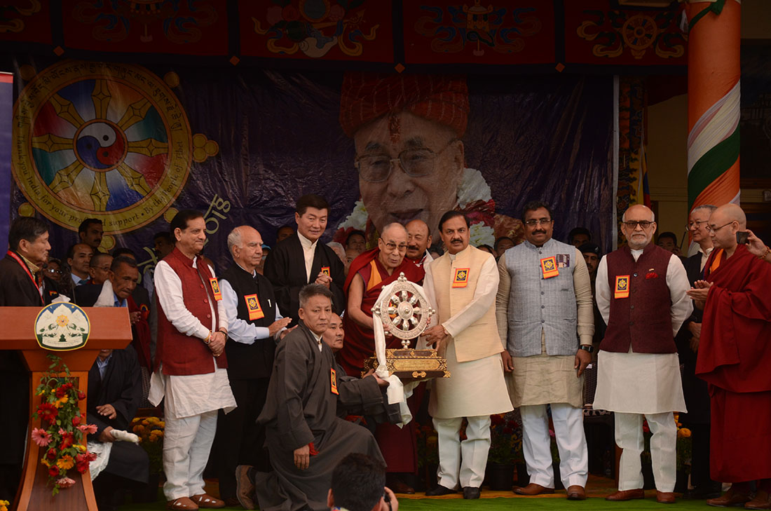 In the presence of His Holiness' presence,  top officials including President Dr Lobsang Sangay, Kalon Karma Yeshi and Kalon Choekyong Wangchuk presenting the ashok chakra to Dr Mahesh Sharma at the main Tibetan temple in Dharamshala, India, on March 31, 2018. Photo: TNO/Chonyi Sangpo