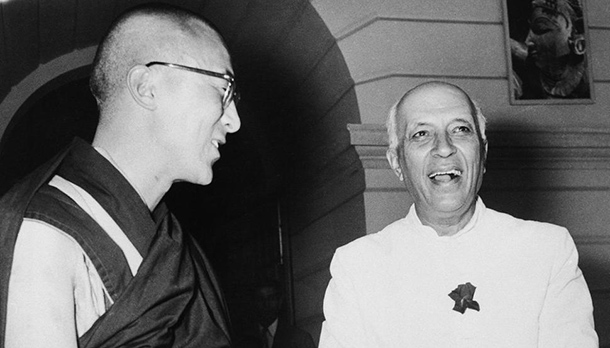 Prime Minister Jawaharlal Nehru clasps hands as he and the Dalai Lama, god king of Tibet, meet at Nehru's New Delhi, India, residence on April 22, 1961, to discuss rehabilitating an estimated 50,000 refugees who fled Tibet when red China took over in 1959. The Dalai Lama is now living in exile in India. (AP)